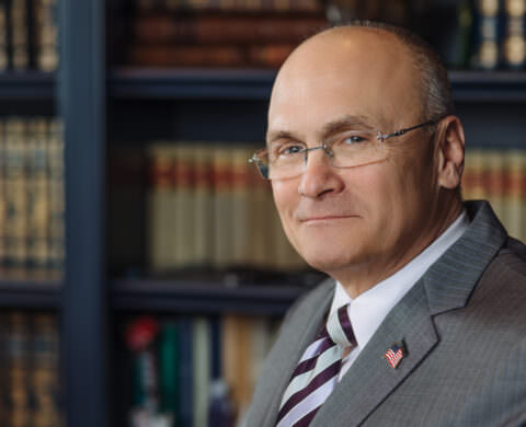 Book Author Andy Puzder in his office with books - Author photo